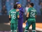 India's captain Virat Kohli congratulates his Pakistan's counterparts Babar Azam and Mohammad Rizwan following their victory.(ANI)