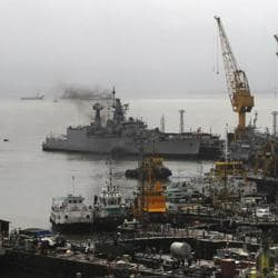 Ships ride at anchors at a naval dockyard where the submarine INSSindhurakshak caught fire and sank after an explosion in Mumbai.