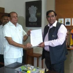 Gujarat Congress MLA Ramsinh Parmar submits his resignation to the assembly speaker on Friday. (Photo: ANITwitter)