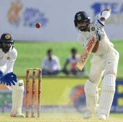 Virat Kohli slammed his 15th fifty while Abhinav Mukund scored his second fifty as India's lead reached 450. Catch live cricket score of India vs Sri Lanka, first Test day 3 from Galle here.