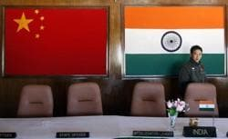 A man walks inside a conference room used for meetings between military commanders of China and India, at the Indian side of the Sino-India border at Bumla in Arunachal Pradesh on November 11, 2009.