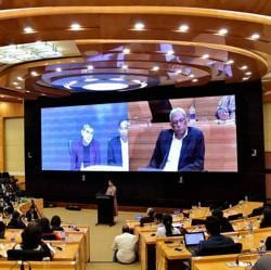 Infosys executive vice chairman and former CEO Vishal Sikka announces the new interim CEO through a video-link from California, as co-chairman Ravi Venkatesan looks on at the company's headquarters in Bengaluru on August 18, 2017.