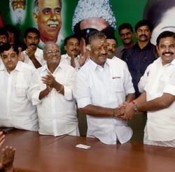Tamil Nadu CM K Palaniswami (R) and O Panneerselvam exchange greetings following the merger of their factions in Chennai on Monday.