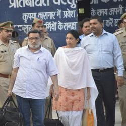 Rajesh and Nupur Talwar walk out of Ghaziabad's Dasna jail on Monday.