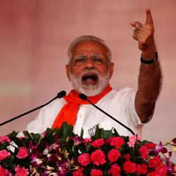 Prime Minister Narendra Modi addresses his supporters during a public rally at Bhaat village on the outskirts of Ahmedabad on October 16.