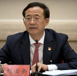 In this photo from October 19, 2017, Liu Shiyu, chairman of the China Securities Regulatory Commission, speaks during a discussion group meeting held on the sidelines of the 19th Communist Party congress at the Great Hall of the People in Beijing. Liu accused the former party secretary of Chongqing, Sun Zhengcai, of plotting a coup against the party leadership in the clearest explanation yet of the abrupt firing of the former rising star.