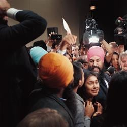 Jagmeet Singh celebrating with supporters after being elected the new leader of the federal New Democratic Party or NDP.