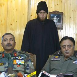 Majid Khan being presented by the army before the media during a press conference in Awantipora on Friday.
