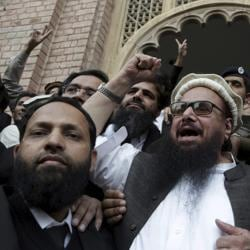Hafiz Saeed gestures outside a court in Lahore, Pakistan.