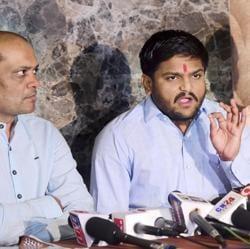 Patidar leader Hardik Patel with Dinesh Bhambaniya (left) addresses a press conference in Ahmedabad on Wednesday.