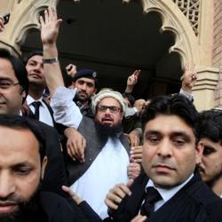 Hafiz Saeed (centre) reacts to supporters as he walks out of court after an order for his release from house arrest in Lahore, Pakistan.