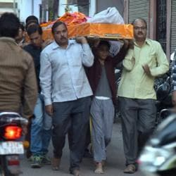 Grieving relatives and acquaintance join Chetan Kumar Saini's funeral procession in Jaipur on Friday. His body was found hanging from the ramparts of the Nahargarh Fort on Friday.