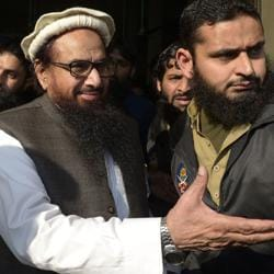 Jamaat-ud-Dawa (JuD) chief Hafiz Saeed arrives to offer Friday prayers at Jamia Al Qadsia Masjid following his release from house arrest in Lahore on November 24, 2017. Saeed, who heads the UN-listed terror group and has a $10 million US bounty on his head, was freed after nearly 10 months in detention.