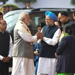 Prime Minister Narendra Modi greets former PM Manmohan Singh during a ceremony for the martyrs of the 2001 Parliament attack at Parliament House in New Delhi on Wednesday.