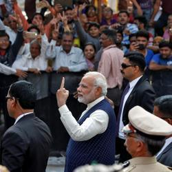 Prime Minister Narendra Modi shows his ink-marked finger after casting his vote outside a polling station during the last phase of Gujarat assembly election in Ahmedabad on Thursday.