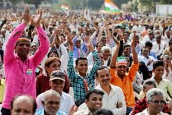 Congress supporters during an election campaign meeting Gujarat's in Dakor. Analysts have predicted that the opposition party could give the BJP, which has been in power in the state for 22 years, a tough fight this time around.