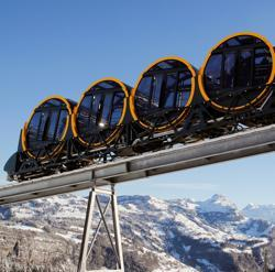 The barrel-shaped carriages of a new funicular line are seen during sunny winter weather in the Alpine resort of Stoos, Switzerland.
