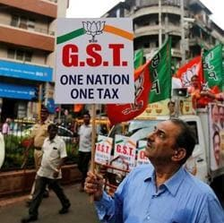 File photo of a BJP supporter at a rally to support implementation of the Goods and Services Tax (GST) in Mumbai.  Tax and IT consultants who worked on the project say government is still making changes to tax rates, filing deadlines, and other features, making it difficult to stabilise the system.