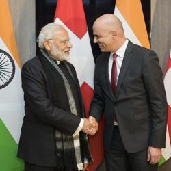 Prime Minister Narendra Modi and Swiss Federal President Alain Berset shake hands prior to a meeting one day before the start of the 48th annual meeting of the World Economic Forum in Davos, Switzerland.