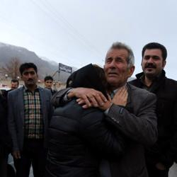 Relatives of a passenger who was believed to have been killed in a plane crash react near the town of Semirom, Iran