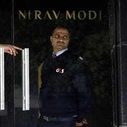 A security guard stands guard inside a Nirav Modi showroom during a raid by Enforcement Directoratein New Delhi on February 15.