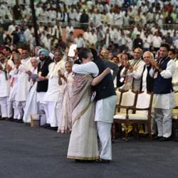 Congress president Rahul Gandhi hugs his mother, Sonia Gandhi, after her speech at the 84th Plenary Session of the Indian National Congress (INC) at the Indira Gandhi Stadium in New Delhi on Saturday.