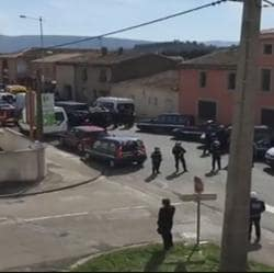 The area outside the supermarket in Trebes, south-western France, where a hostage situation is underway.
