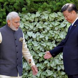 Prime Minister Narendra Modi(L) and Chinese President Xi Jinping leave after a group picture during BRICSSummit in Benaulim, in Goa, on October 16, 2016.