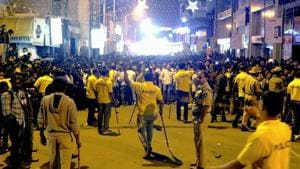 Policemen attempt to manage crowds during New Year's eve celebrations in Bengaluru on December 31, 2016.(AFP File Photo)