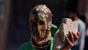 A masked protester holds stones during a protest in Srinagar, April 28, 2017(REUTERS)