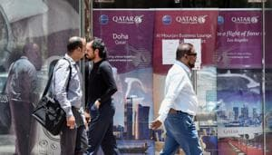 People walk past the Qatar Airways branch in the Saudi capital Riyadh, after it had suspended all flights to Saudi Arabia following a severing of relations between major Gulf states and gas-rich Qatar. Saudi Arabia was among the nations that closed its borders with Qatar, effectively blocking food and other supplies exported by land to Qatar.(AFP)