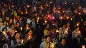 Hundreds take part in a vigil to pay respects to those killed in clashes with police during an indefinite strike in Darjeeling on June 19, 2017. Protesters on June 18 paraded with coffins containing the bodies of two men they claimed were killed in clashes with Indian security forces in Darjeeling, as the hill resort reels from separatist unrest.(AFP Photo)