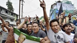 Darjeeling: Gorkha Janamukti Morcha supporters shout slogans at a protest rally during their indefinite strike in Darjeeling on Monday.(PTI)