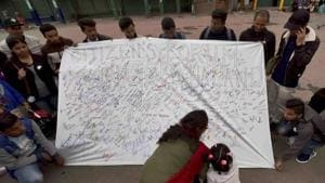 People participate in a signature campaign demanding for separate state of Gorkhaland in Darjeeling on Thursday.(PTI Photo)