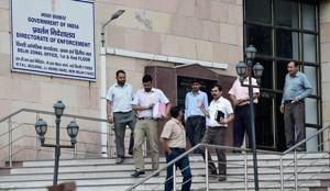 Officials at the Directorate of Enforcement office. The ED, which probes financial crimes, raided the Sandesara group on Saturday. The group's flagship company, Sterling Biotech, is one of the top 10 defaulters of PSU banks and the loan was declared NPA in 2012.(PTI FILE)