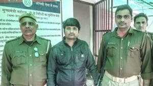 Dinesh Verma (in black jacket) was absconding after he allegedly shot dead Sharma near Durga Tent House in Dankaur around 11.30pm on Monday.