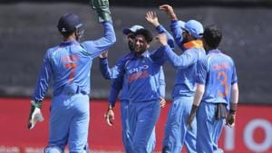 Kuldeep Yadav, centre, and teammates celebrate the wicket of Aiden Markram during the third ODI between South Africa and India in Cape Town. Follow highlights of India vs South Africa, 3rd ODI in Cape Town here.(AP)