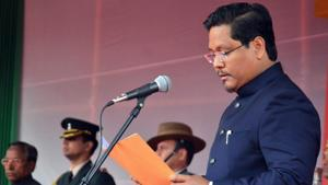 National People's Party (NPP) president Conrad K Sangma takes oath as Meghalaya chief minister during a swearing-in ceremony in Shillong on Tuesday.(PTI Photo)