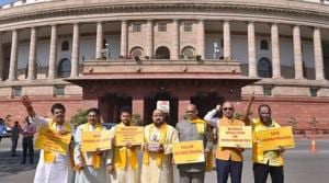 TDP leaders hold placards and raise slogans demanding special status for Andhra Pradesh during the Budget Session in Parliament on Tuesday.(PTI)