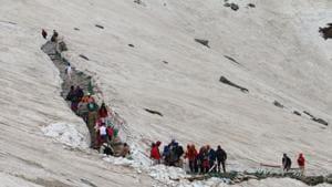Sikh pilgrims passing through the glaciers to reach the Hemkund Sahib Gurudwara in Uttarakhand.(HT File Photo)