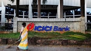 FILE PHOTO: A municipal worker walks past a logo of ICICI Bank at its headquarters in Mumbai October 25, 2013. REUTERS/Danish Siddiqui/File Photo GLOBAL BUSINESS WEEK AHEAD SEARCH GLOBAL BUSINESS 29 JAN FOR ALL IMAGES(REUTERS File Photo)