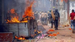 Police personnel patrol after a clashes and incidents of arson took place over a Ram Navami procession at Raniganj in Burdwan district on March 26.(PTI Photo)