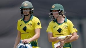 Australia cricketers Meg Lanning (R) and Ellyse Perry walk back to the pavilion after winning the fifth cricket match of the women's Twenty20 tri-series vs England at the Brabourne Stadium in Mumbai on Wednesday.(AFP)