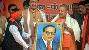 UP Chief Minister Yogi Aditya Nath being presented a portrait of Dr BR Ambedkar during an election rally Allahabad on March 3, 2018.(PTI File Photo)