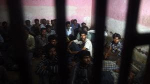 Indian fisherman sit in a police lockup in Karachi on March 26, 2017 after they were arrested by Pakistan coast guards.(AFP File Photo)