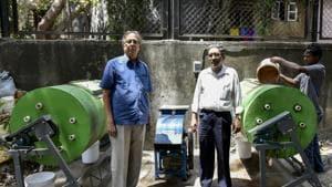 (left) CM Lakshman, manager, Eucress Co-operative Housing Society and Kevin David, secretary of the society near the composting plant installed at Eucress Society in Wadala, Mumbai.(KUNAL PATIL/HT PHOTO)