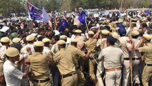 Police personnel try to disperse the protesters who were trying to block the Delhi-Gurugram expressway near Rajiv Chowk during Bharat Bandh call in Gurugram on Monday.(PTI Photo)