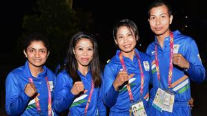 Indian boxing contingent (L-R) Pinki Rani Jangra, Mary Kom, Sarita Devi Laishram and Lovlina Borgohain during the country's flag-hoisting ceremony at the Commonwealth Games 2018 in Gold Coast.(PTI)