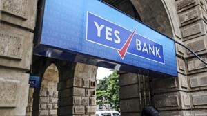 A man walks past by Yes Bank Ltd. branch in Mumbai, India.(Dhiraj Singh/Bloomberg)