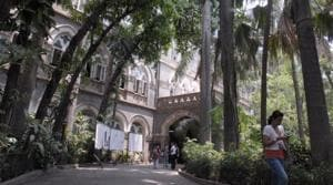 The BMC aims to make heritage structures such as St Xavier's College on Mahapalika Marg more visible from the streets and give tourists a comfortable place to stroll.(HT File Photo)